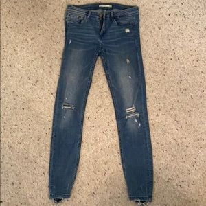 Mid Rise Skinny Jeans With Rips